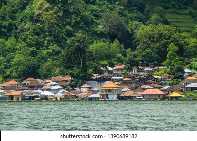Life of Trunyan Village at Batur lake and volcano, Kintamani, Bali, Indonesia. Trunyan is one of the culturally isolated Bali Aga village in Bali.