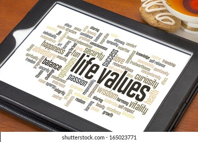 life values - word cloud on a  digital tablet with a cup of tea
