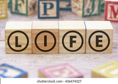 LIfe word written on wood cube