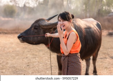 The life of a young woman with buffalo in the countryside.