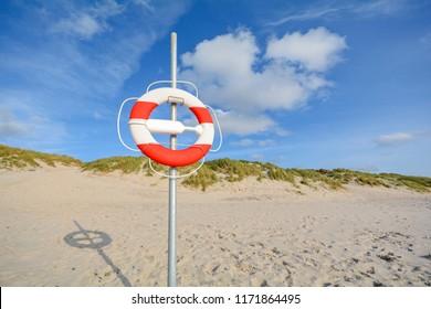 Lifebelt at beach and sand dunes near Blavand, Jutland Denmark Europe