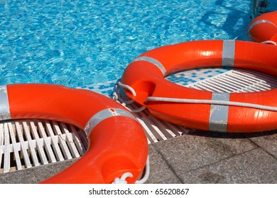 Life-belts near the water of a pool