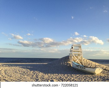 A lifeboat and lifeguard chair on the beach at Jones Beach State Park on Long Island, NY.