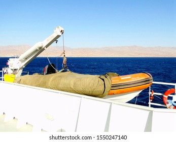 A lifeboat on a moving yacht. A lifeboat on a travel yacht, way from Aqaba in Jordan to Dahab in Egypt, moving on Red Sea in Middle East area.