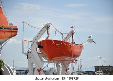 Lifeboat secured to large ship in the port of Rijeka,Croatia