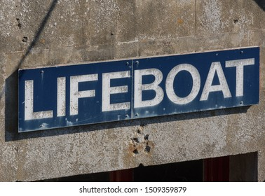 """Lifeboat"" Sign Attached at the Entrance to the Lifeboat Station in the Seaside Fishing Village of Mousehole in Rural Cornwall, England, UK"