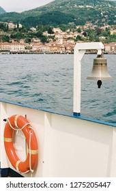 Lifebuoy and bell on board of boat in lake Como, Italy