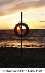 Lifebuoy in the evening with waves in the background