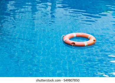 lifebuoy floating in swimming pool