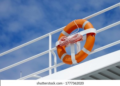 Lifebuoy hanging on a Iron railings of the boat With a background sky security concept , Ideal for use in the design put images and insert text