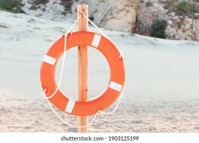 lifebuoy on the beach at the resort. Concept of vacation and safety when swimming in the sea