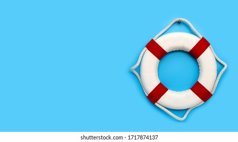 Lifebuoy on blue background. Copy space