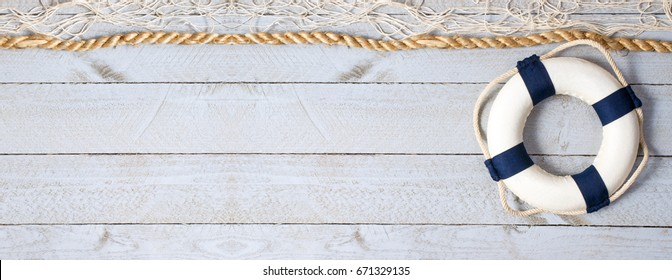 Lifebuoy on empty horizontal wooden background - copy space for individual text