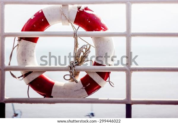 lifebuoy on the railing of the ship