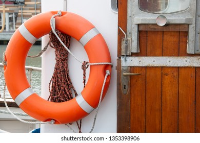 Lifebuoy on a ship's wall on a boat with entrance door