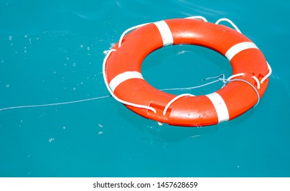 Lifebuoy on the surface of the water. Summer vacation at sea