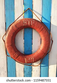 A lifebuoy on white and blue placks