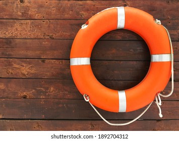 Lifebuoy on a wooden background. Help, rescue concept. Copy space.