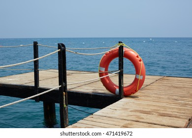 Lifebuoy on wooden pier