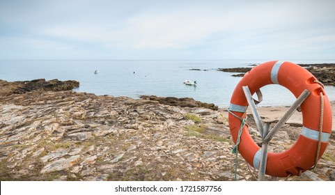 lifebuoy at sea in a small port on an island in France