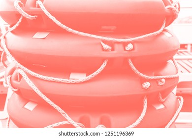 Lifebuoys on the ship are stacked. Color of the year 2019 Living Coral. Popular trend palette for design illustrations, fabrics, fashion, images. Tinted background