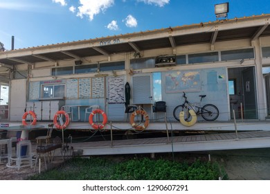 Lifeguard booth on the Cyprus Paphos beach with bike and life rings in winer time in January 2019