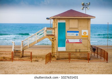 Lifeguard booth stands at the shore line on the beach