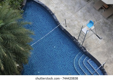 lifeguard chair beside the swimming pool