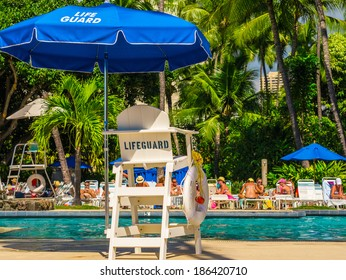 A lifeguard chair next to pool for guard to save life and make swimming safe