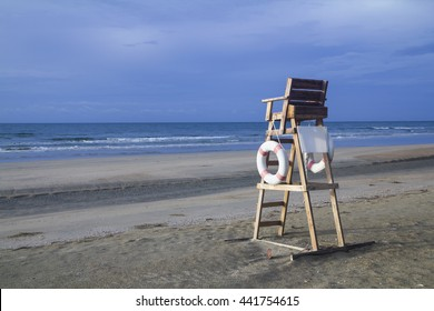Lifeguard chair on an emply stormy beach and overcast cloudy sky on bad weather day