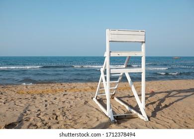lifeguard chair on empty beach, lifeguard tower