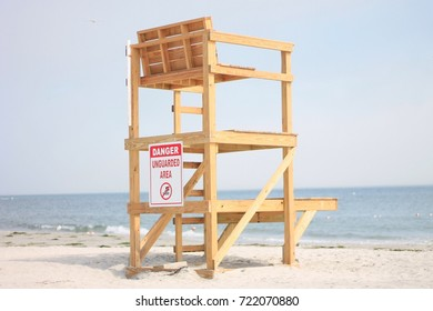 A lifeguard chair on an empty beach in the fall.