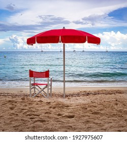 Lifeguard Chair and parasol at empty beach of Fetovaia, Island of Elba, Tuscany, Italy; swimmers rescue and safety concept