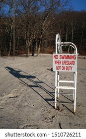 Lifeguard chair with sign that says, NO SWIMMING WHEN LIFEGUARD NOT ON DUTY.