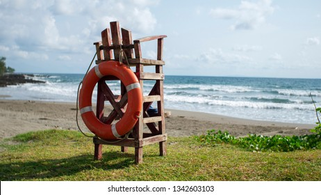 Lifeguard empty watch chair on a hot summer beach.
