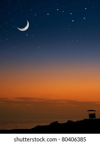 lifeguard house on the beach at the sunset with the Moon and the stars, for tourism,astronomy,nature themes