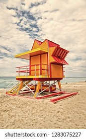 Lifeguard house on sand beach in miami, usa. Tower for rescue baywatch in typical art deco style. South miami beach. Summer vacation concept. Public guarding and safety.