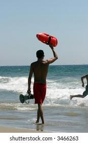 Lifeguard on California beach ready for rescue