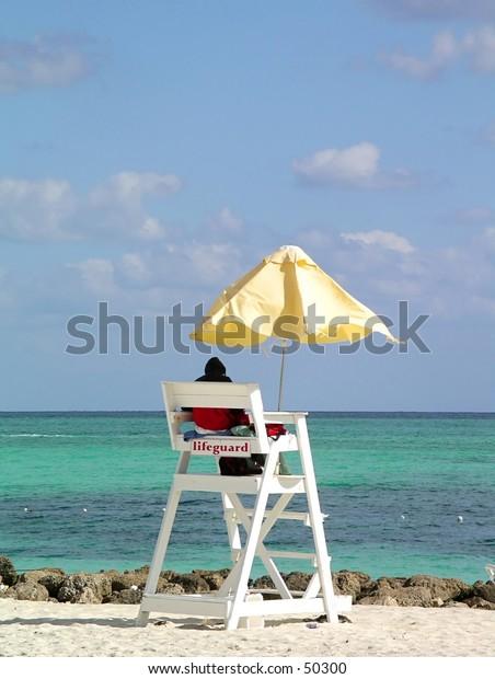 Lifeguard on duty on tropical beach
