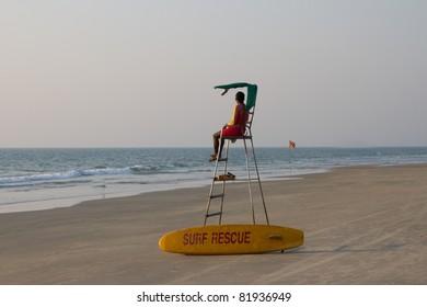 Lifeguard overlooking tropical beach, Goa India