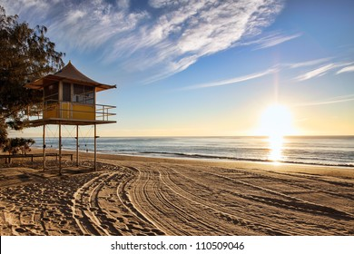 Lifeguard patrol tower on the beach at sunrise, Gold Coast, Australia