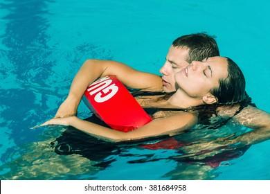 Lifeguard rescuing victim. Toned image