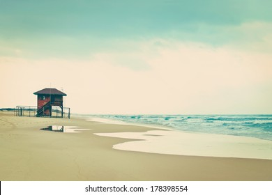 dbc6bdf31883 Lifeguard shack on an empty beach