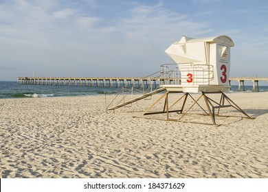 A lifeguard station and the fishing pier in the early morning on Pensacola Beach, Florida.