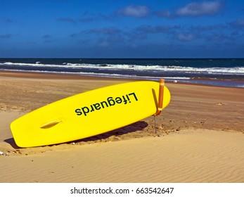 Lifeguard surfboard on sunny beach