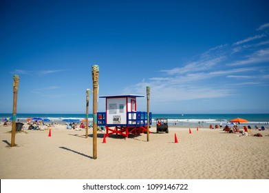 Lifeguard tower facing the water at Cocoa Beach, Florida, USA on a sunny day.