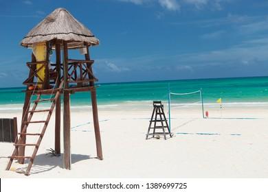 lifeguard tower near a beach voley field in cancun, mexico