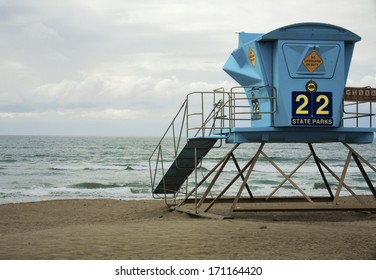 lifeguard tower on the beach in California ocean in the background on a stormy day.