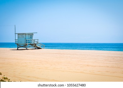Lifeguard tower on an empty beach in Malibu, California
