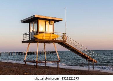 Lifeguard tower on Mediterranean beach in Belek resort town of Antalya province in Turkey, at sunset.